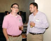 Nathanael Wilson, left, of pair Networks Inc. chats with Mike Buzzelli of Newton Consulting at the August BizMix.