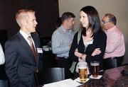 Chuck Reese of Dollar Bank and Erin May of Evolutionare network at BizMix at Villa Southside on Aug. 30.