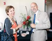 Susan Nitzberg of Standing Firm chats with Bob Schmitt of BNI Western Pennsylvania during BizMix at Villa Southside.