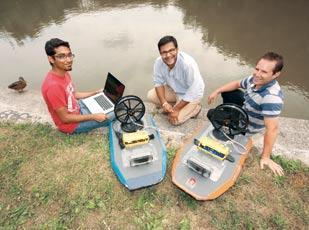 Abhinav Valada, left, Balajee Kannan and Paul Scerri are among the co-founders of Platypus LLC. The company makes autonomous robotic airboats that measure water quality parameters.