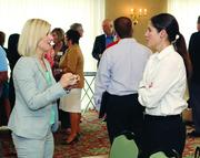 Kate Gatto of Robert Morris University, left, chats with Jennifer Frazier of Kforce Inc.