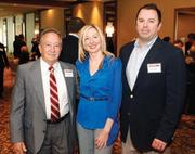 Award winner Angela Piermani Comas of Meyer, Unkovic & Scott LLP was joined by her father, Tony Piermani, left, and her husband, Tony Comas of Burns White at the event.