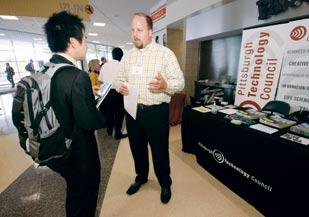 Justin Driscoll, director of STEM Talent Acquisition for the Pittsburgh Technology Council, chats with a student during a career fair Sept. 25 at Petersen Events Center.