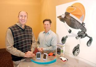 Thorley Industries CEO Rob Daley, left, and CTO Henry Thorne are in the middle of launching the company's roboticized stroller, the Origami, shown at right.