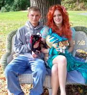Andy Holderny, Lita Shields and their cats Beanie and General at Animal Friends' Howl-o-Ween pet costume party in Schenley Park.