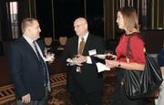 FedEx Ground's Todd Shipley, left, Chaz Rauzan and Kelly Sullinger mingle at the event.