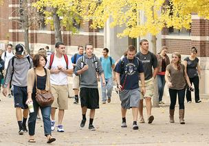 Duquesne University students make their way across campus between classes. The school's retention rate is much higher than the national average.