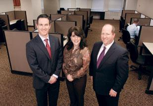 SDLC principal partners Scott Barnyak, left, Christy Maruca, center, and Chris  Simchick stand in their new offices at Three Gateway Center, Downtown.