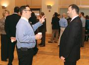 Eric Booth of Desmone & Associates Architects, left, chats with Christopher Flickinger of Dale Carnegie Systems at the event.
