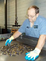 A worker in Kennametal's Kingston facility in Latrobe sorts scrap for recycling.