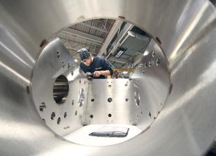 Troy Cox grinds gussets in a stainless steel vacuum chamber at Kurt J. Lesker Co.'s Clairton facility.