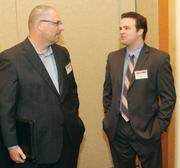 Erich Landis, NorthEast Energy Advisors, left, mingles with Patrick Cersosimo, Newmark Grubb Knight Frank, at the event.