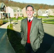 Northwood Realty's Steve Carpenter stands on a street in Kauffman Run in the Adams Ridge development in Adams Township. Carpenter said diverse business opportunities have driven a population boom that's benefited residential real estate.