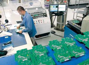 Doug Hodges de-panelizes printed circuit boards at AccuSpec Electronics LLC in Erie.
