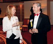 Kristiina Baker, c3controls, talks with Larry Barger, Alpern Rosenthal, prior to the Manufacturer of the Year awards ceremony.