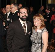 Joe Serkoch of Orionvega, left, and Lisa Wittig of Levy MG attend the Manufacturer of the Year event.