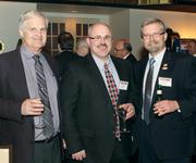 Fyda Freightliner Pittsburgh Inc.'s Paul Naman, left, Bob Bodkin, center, and Tim Hooker mingle during the Manufacturer of the Year Awards.
