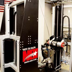 NETL is using this industrial CT scanner and others to research how gas flows through the pores of Marcellus Shale rock.