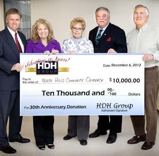 Fay Morgan, second from left, executive director of North Hills Community Outreach, accepts a $10,000 check for her organization from HDH Group. With her, from left, are Florian Rajakovich of HDH; Lenore Pope of HDH; Shaler Township Manager Tim Rogers, who nominated North Hills for the award; and Bryan Hondru of HDH.