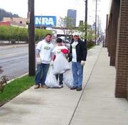 Chuck Hammel and his sons, Chuck IV, left, and Max, center, participate in a community cleanup effort in Pittsburgh. The Great Pitt Ohio Cleanup is conducted at all of the company's terminals each year to coincide with Earth Day.
