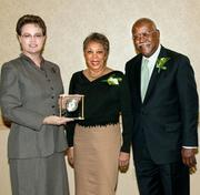 Karen Galentine, left, president of the Western Pennsylvania Chapter of the Association of Fundraising Professionals, presents Judith and Ronald Davenport, founders of Sheridan Broadcasting Corp., with the Outstanding Philanthropists award.