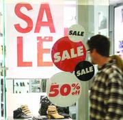 Shoppers pass a storefront display at South Hills Village. The mall is undergoing several renovations and upgrades.