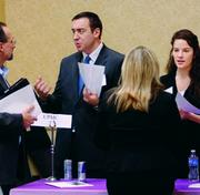UPMC recruiter Ryan Hudson and Emma Fazio, project coordinator of human resources, speak with job seekers at a Pittsburgh Tech Council Hire Up event earlier this month. UPMC is looking to hire about 500 people.