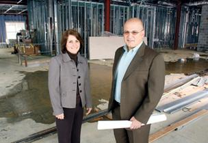 Dr. Kathryn Ryan and Dr. Tony Smaldino stand in a construction area at South Butler Commons