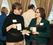 Jennifer Sciullo, Gateway Rehab, left, talks with Julie Shepard, The Pittsburgh Promise.