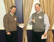 Jeff Dunn, left, and Ray Passieu of Freight Management Plus enjoy the breakfast and drinks available at the event.