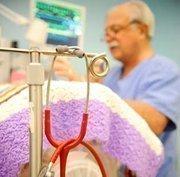 Dr. Alan Lantzy checks on the status of a newborn at West Penn Hospital.