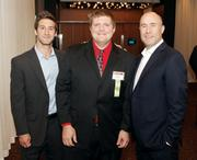 Fast Tracker Fred Hopke of 4moms, center, is flanked by co-workers Brian Grochal, left, and Rob Daiey.
