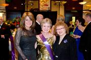 Kim Tillotson Fleming (center), CEO of Hefren-Tillotson Inc., is flanked by Deb Rice Johnson, left, and Joyce Bender at the 19th Annual Mardi Gras Gala. Fleming was named this year's king.