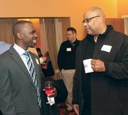 Carlos Carter, left, of Bank of America Merrill Lynch, chats with John Blanton of Schneider's Dairy.