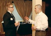 Matt Dolan, left, of Steel River Techs LLC chats with Justin Scott of Consulting Professional Resources Inc.