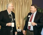 Bob Nelson, left, of Strategy Matters chats with Mike Duffy of First Niagara Equipment & Municipal Finance.