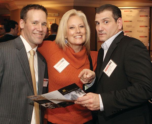 Gentech's Jeffrey Coulter, left and Stephanie Verona were joined by Vince Chisler of Brothers Lazer Service Inc.
