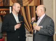 Casey Ellis, left, of The Rivers Club chats with Mark Grasso of Oxford Development.