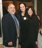 Mark Schenck of Comcast Business Class joined Openarc's Jordan Gehlmann, center, and Bethany Simon.