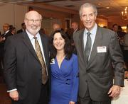 Joe Smith, left, of Dollar Bank, Connie George of VisitPittsburgh and Bob Fragasso of Fragasso Financial Advisors.