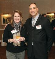 Betsy Benson of Pittsburgh Magazine and Dennis Lejeck of Black Knight Security.