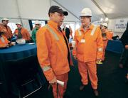 U.S. Steel Corp. CEO John Surma, left, and Allegheny County Executive Rich Fitzgerald chat before the C Battery Commissioning festivities at the U.S. Steel Clairton.