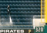 """The outfield All-You-Can-Eat Seats at PNC Park are powerwashed Tuesday, April 3, 2012, in preparation for Thursday's Pittsburgh Pirates home opener with the Philadelphia Phillies. Things didn't work out so well for the Pirates after a promising half of the year, a situation that owner Bob Nutting told KDKA-TV that he would be """"reviewing all sorts of alternatives."""""""