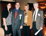 Diamond Award winner Mike Cherock of AE Works is flanked by his wife, Laura, his mother, Jean Dean, and his stepfather, Walt Dean. For more coverage of the Diamond Award winners, see our special section: http://bizj.us/b5zbj