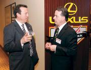 Earl Martin, left, of First Commonwealth Bank chats with James Zern of Smithfield Trust. For more coverage of the Diamond Award winners, see our special section: http://bizj.us/b5zbj