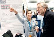 John Mather, who won a Nobel Prize for physics in 2006, listens to Fang-Yu Chang, 16, of Taiwan, speak about her project on display at the Intel International Science and Engineering Fair 2012, held in May at the David L. Lawrence Convention Center. Mather was one of eight Nobel Laureates participating in an Excellence in Science and Technology Discussion Panel.