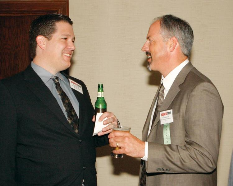 Adam Tobia, left, of MarkWest Energy Partners LLC chats with Scott Rusmisel of The Gateway Engineers, Inc. prior to the Energy Leadership Awards May 17, 2012.
