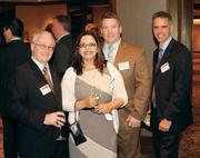 Herbein + Company, Inc.'s Thomas Bakaitus, Jr., far left, and Greg Farrell, far right, were joined by Renaissance Pittsburgh Hotel's Carola Molinares and Visit Pittsburgh's Mont Handley prior to the Energy Leadership Awards May 17, 2012.