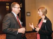 Dewitt Peart, left, of Pittsburgh Regional Alliance chats with Petra Mitchell of Catalyst Connection prior to the Energy Leadership Awards May 17, 2012.