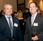 Bill Zollars, left, of BPL Global chats with Jim Wilson of Duquesne Light Holdings prior to the Energy Leadership Awards May 17, 2012